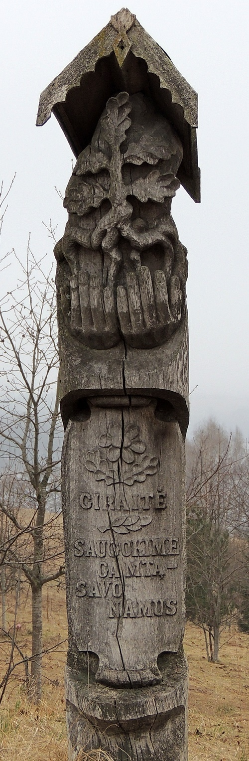 Lithuanian Folk sculpture. Lithuanian Wooden sculpture with the words meaning Protect your mother - nature