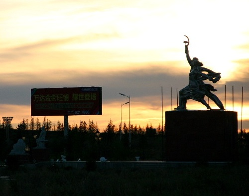 The Worker and Collective farm woman at the sunset. Copy of the famous monument by Vera Mukhina.