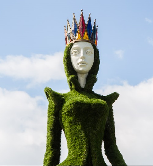 Topiary sculpture of Copper Maid, keeper of Ural precious stones of Ural mountains