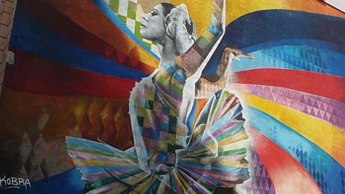 Graffiti on the wall with the image of Maya Plisetskaya. Artist Cobra