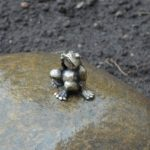 Frog-traveler smallest monument in the world