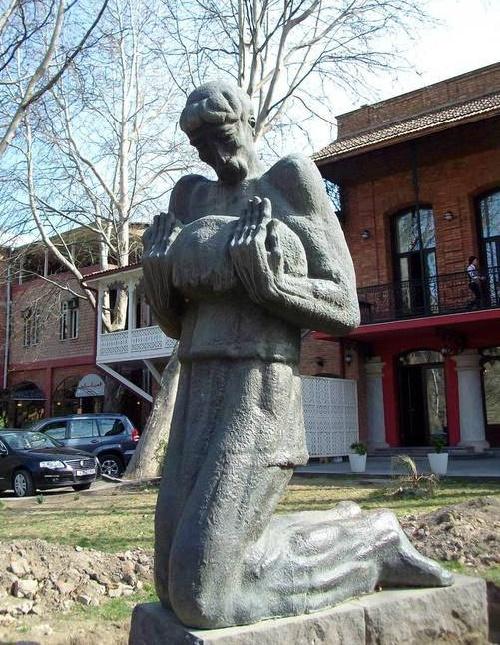 Niko Pirosmanashvili monument with lamb. The sculptor Elguja Amashukeli. 1975 Bronze, granite. Tbilisi
