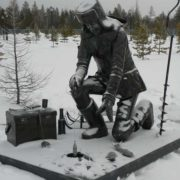 The city of Noyabrsk (Yamalo-Nenets Autonomous District), a monument of a fisherman on winter fishing