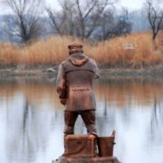 Trofimych - bronze sculpture of a fisherman in the town of Kamensk-Shakhtinsky of Rostov region