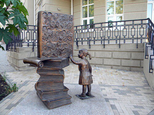 Monuments dedicated to books and reading. A girl with a book. Taganrog, 2010