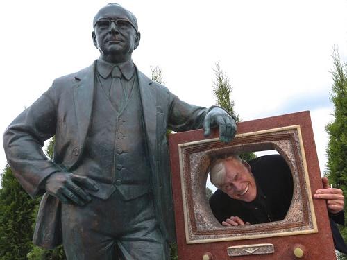 Russian actor Boris Shcherbakov posing next to the inventor