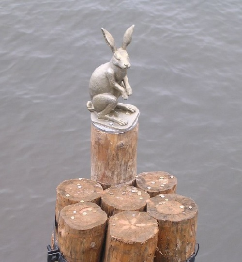 Escaped flooding little hare monument in St. Petersburg