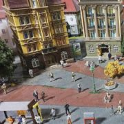 Miniature world with architecture and figures of people