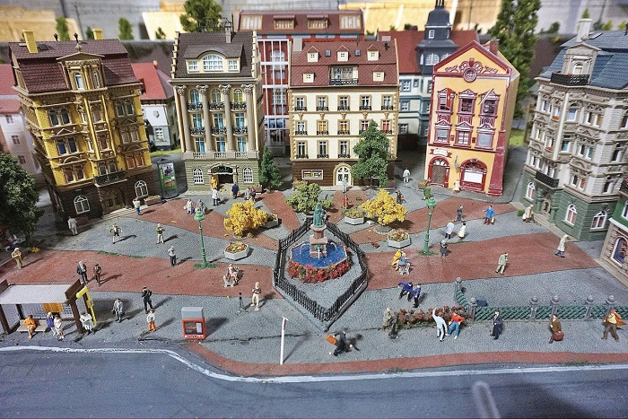 One-of-a-kind miniature world with architecture and figures of people