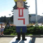 Pixel figures representing Soviet people in national costumes