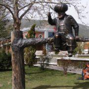 Sitting on a tree trunk, Nasreddin. Turkey