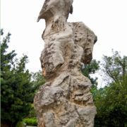 Stone sculpture of curious shapes decorate the paths in the gardens next to Gragonfly Lake