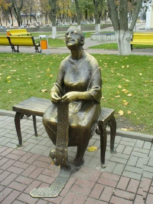 A bronze knitter in Belgorod (Russia) sits alone on a bench and dreams about something, and maybe recalls something good ...