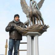 Anton Tyryshkin with his creation, Stork sculpture in Novokuznetsk