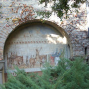 One of the walls decorated with painting