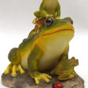 Porcelain sculpture of frogs