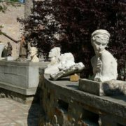 Various sculptures and busts decorate the perimeter of the castle
