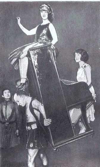 Russian athlete Alexander Zass holding a piano and two women