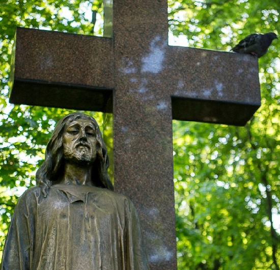 Fragment of the Miraculous Christ tombstone sculpture at the Novodevichy Cemetery