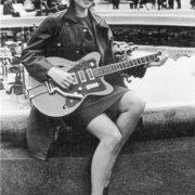 Playing the guitar, youg Lyubov Polishchuk