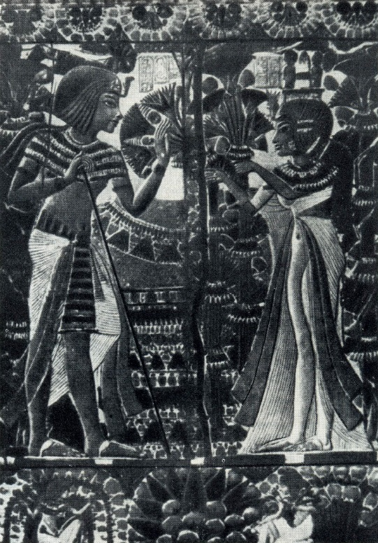 Tutankhamun with his wife in the garden. Relief on the lid of the casket