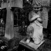 A cross and an angel boy