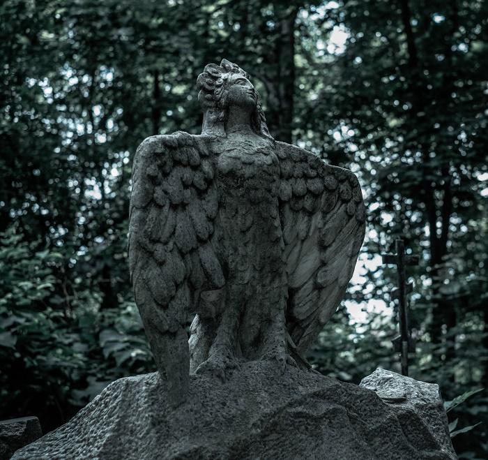 Sculpture of Bird Syrin on the grave of Russian writer Mikhail Mikhailovich Prishvin. Vvedensky Cemetery, Moscow