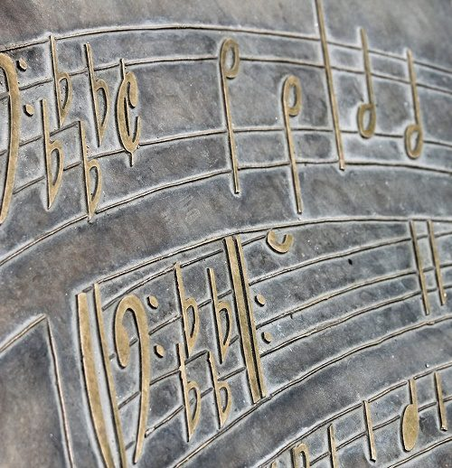 music notes, detail of the monument