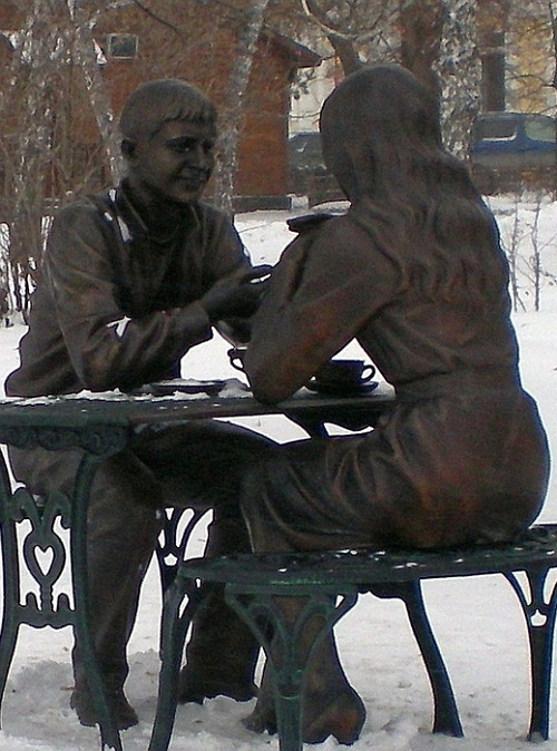 Sculptural Composition 'Meeting' in Vrubel Square of the Siberian city of Omsk, Russia. Sculptor Ilya Mishanin