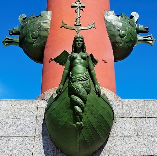 Sculpture of Rostral column of St. Petersburg. Russian traditional ship sculpture