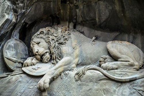 The stone sculpture of a dying Lion