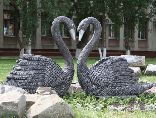 Two Black Swans monument symbolizing Miner faithfulness decorate Kirov Square in Kemerovo, the south-eastern Siberia, Russia