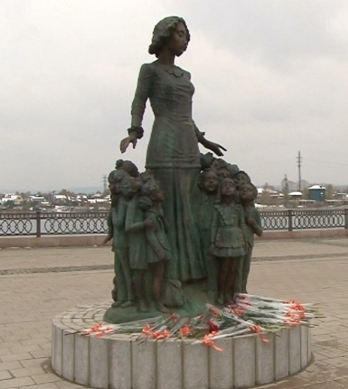 Teacher monuments throughout Russia. The first teacher surrounded by children. Irkutsk
