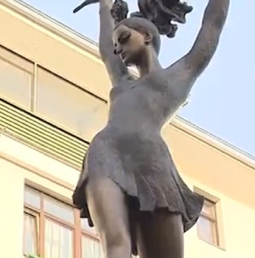 The composition depicts a dancing ballerina in the role of Carmen