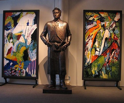 Russian artist Kandinsky. Monument surrounded by two enamels with abstractions of his work