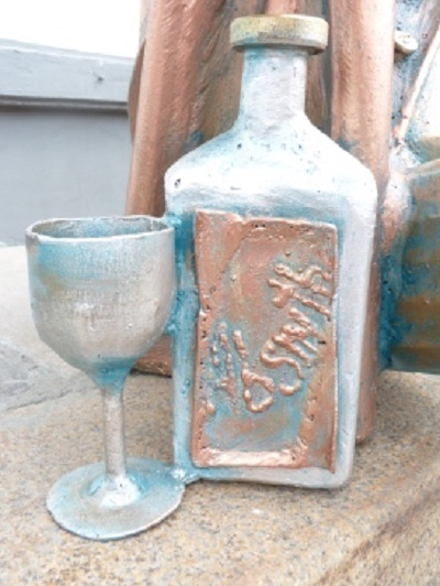 Detail of the monument - A bottle of Absinthe and a wine glass