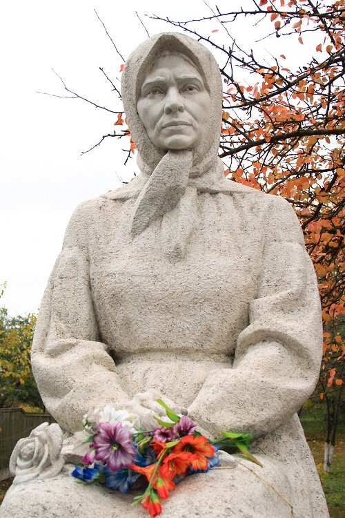 Monument to self-taught naive artist Katerina Bilokur. Sculptor - nephew of the artist, Ivan Bilokur. The village of Bogdanovka of Yagotin district, Kiev region