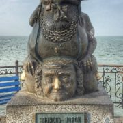 Monument to Human vices - jealousy and greed. Berdyansk, Ukraine