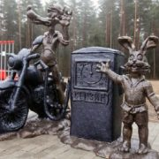 Petrol station, monument to characters of Soviet cartoon - wolf and hare. Russia