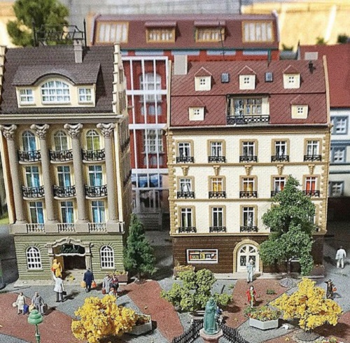 Beautiful miniature world with architecture and figures of people