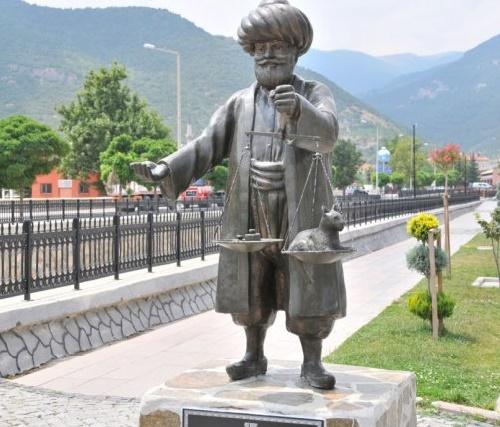 Holding scales Nasreddin Hodja