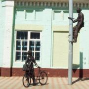 Meanwhile, the Yelabuga postwoman with a bicycle is not alone. Next to her - is the sculpture of electrician