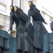Women in black - Three graces (above the entrance to the National Drama Theater) in Vilnius, Lithuania