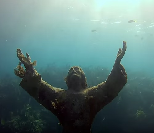 Jesus Christ monument asking for peace from underwater
