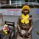 Korean Comfort women touching monument