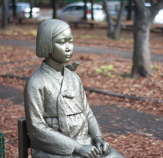 Korean Comfort women touching monument