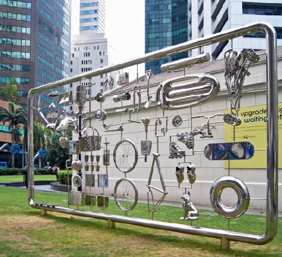 Art installation - various mechanisms and metal details decorate the grate. Singapore most notable monuments