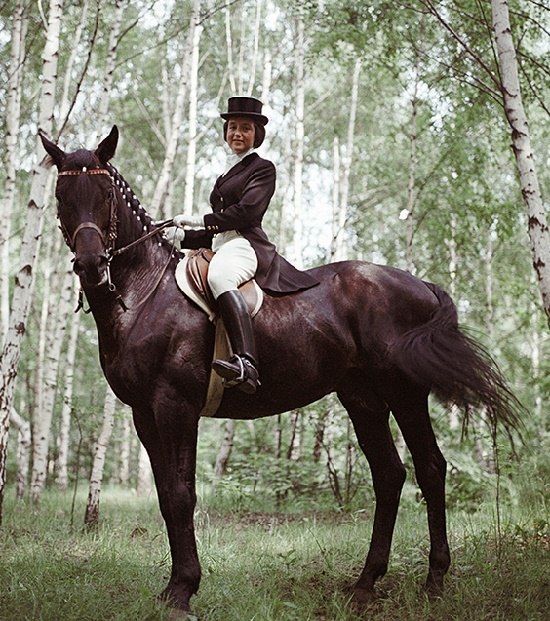Beautiful equestrian Elena Petushkova on her black horse Pepel