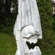 Mother and child wooden sculpture in Yaroslavl, Russia