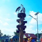 Barnaul, Russia. Monument little family of storks in the park Harlequin